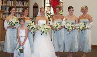 Bridal Party Picture from a June Wedding, with White Free-form Boquets of Mountain Lilies, Tulips, Roses, Dendrobium Orchids, Italian Ruscus, Mini Variegated Pittosporum