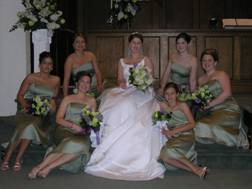 May Bridal Party Picture, Holding Round Clutches of Green Jade Roses, White Lilac, Purple Hyacinths, Green Vibernum, and a Collar of Salal Leaves